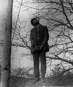 A black man hanging from a tree