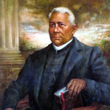Portrait of an African American clergyman, holding a bible. Blue suit with white collar.